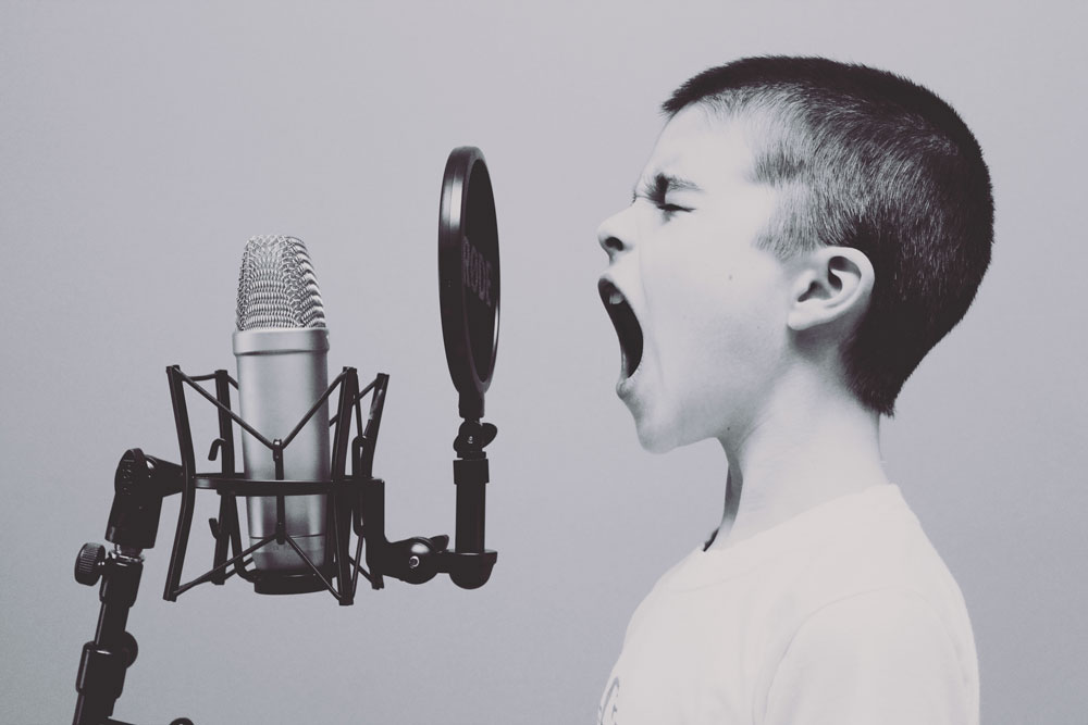 Boy singing in microphone